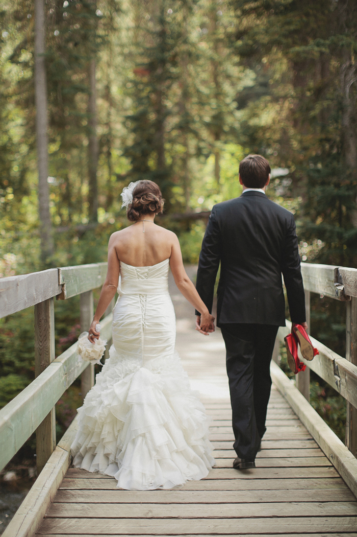 Wedding couple walking across a bridge