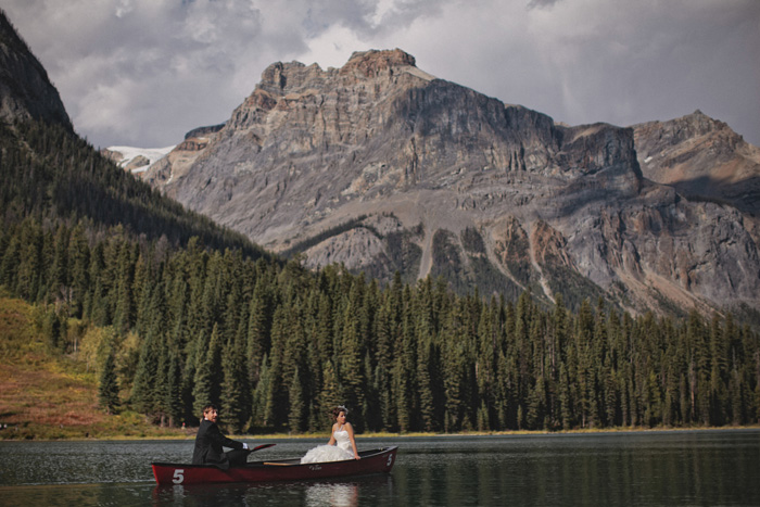 Bride and groom canoeing on a lake