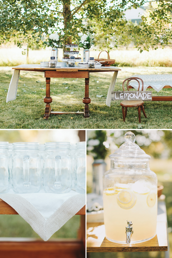 Backyard wedding refreshment table with lemonade and cupcakes