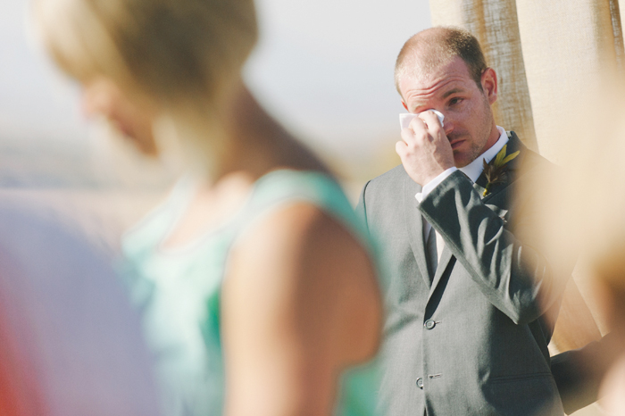 Groom crying when he first sees his bride coming down the aisle
