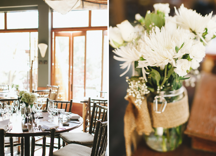 Burlap and white flower centrepieces at rustic restuarant