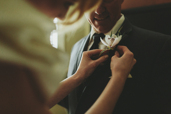 Bride pinning her father's boutonniere in the Canadian Rocky Mountains